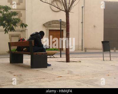 Immigrant, Lleida, Spain - Stock Photo