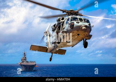 PACIFIC OCEAN (Sept. 12, 2016) A U. S. Navy MH-60S Seahawk from the USS Bonhomme Richard (LHD 6) maneuvers during - Stock Photo