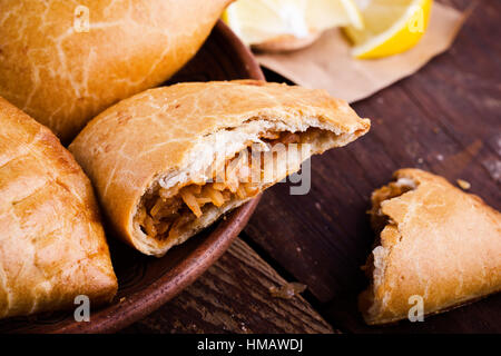 Homemade baked vegetarian empanadas, Latin-American-style stuffed vegetables pie with stewed  cabbage, carrots, - Stock Photo