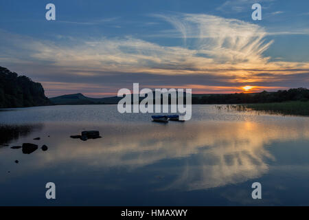 Hadrian's Wall: the open water of Crag Lough lies below Highshield Crags and here is viewed at sunset from its eastern - Stock Photo