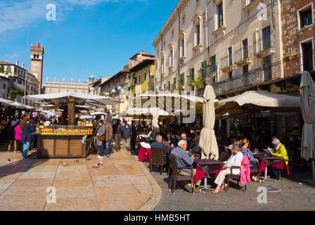 Cafe and restaurant terraces, Piazza delle Erbe, Verona, Veneto, Italy - Stock Photo