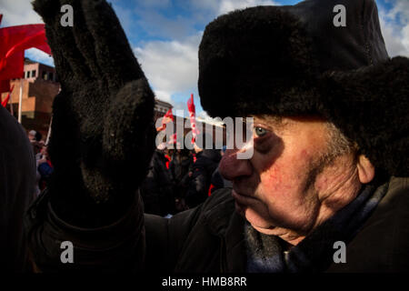 Old man stay in queue waiting to visit the Lenin mausoleum in the Red Square of Moscow, Russia - Stock Photo