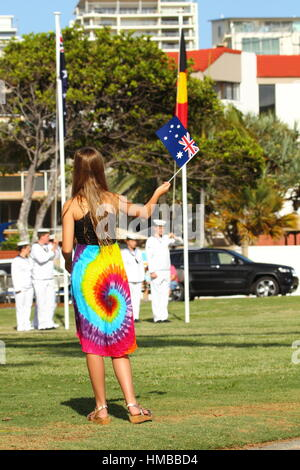 A young pre-teen girl waves a small Australian Flag during the 2017 Australia Day Celebrations at Kings Beach, Caloundra, - Stock Photo