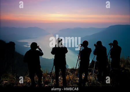 Sunset in the hill sihouette photographer - Stock Photo