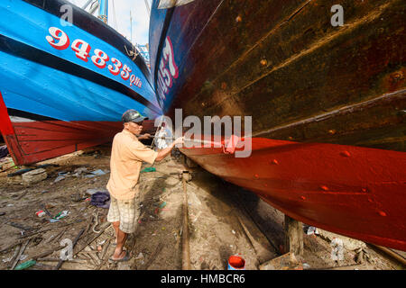 Painting boats in the fishing village, Hoi An, Vietnam - Stock Photo