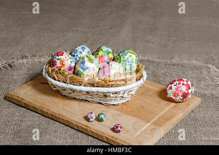 Decoupage Easter eggs are handmade in the basket - Stock Photo