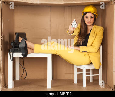 builder shows a prototype of a new home for you - Stock Photo