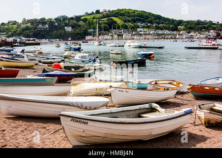 Boats on The Estuary Beach at Teignmouth With Boats Moored in the Teign Estuary, Teignmouth, Devon, England. - Stock Photo