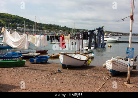 Laundry and Boats on The Estuary Beach at Teignmouth With Boats Moored in the Teign Estuary, Teignmouth, Devon, - Stock Photo