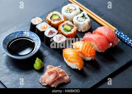 Salmon and tuna sushi on black slate plate - Stock Photo