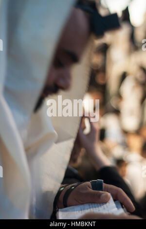 MERON, ISRAEL - MAY 18, 2014: Orthodox Jews prays a sunrise (Shacharit) pray at the annual hillulah (celebration) - Stock Photo