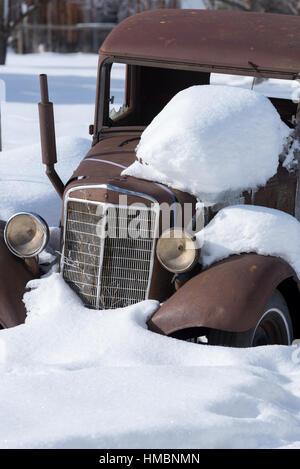 Old car in winter, Joseph, Oregon. - Stock Photo