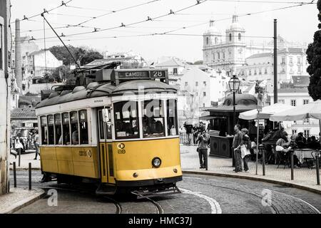 Classic vintage tram route 28 in Alfama district in Lisbon Portugal. - Stock Photo