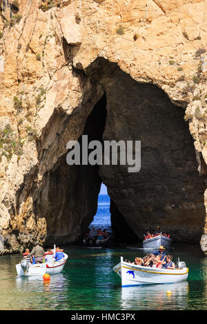 excursion boats travelling from the inland lagoon through the arch to the azure window, gozo, malta - Stock Photo