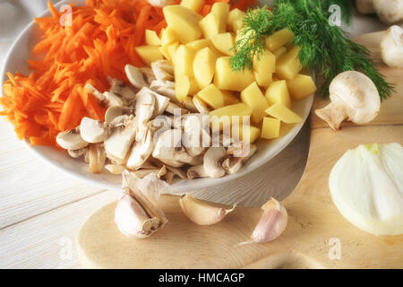 chopped ingredients for soup on plate - Stock Photo