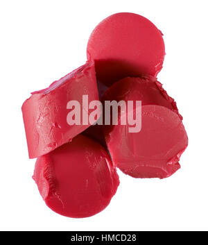 A cut out beauty image of a sample of chopped red lipstick - Stock Photo