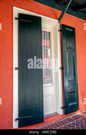 White Door, Green Shutters, Window and Pink Wall in the French Quarter, New Orleans LA USA - Stock Photo