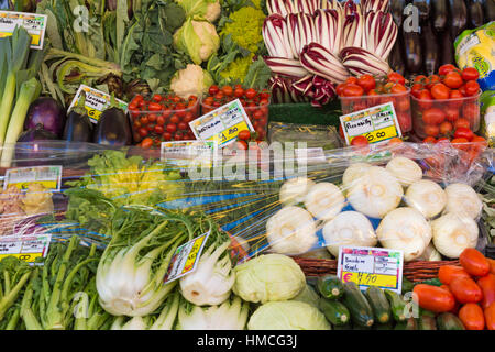 Vegetables for sale on market stall at Venice, Italy in January - Stock Photo