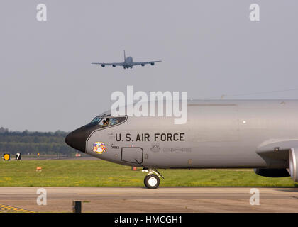 United States Air Force Boeing KC-135R Stratotanker 58-0093 taxies at RAF Mildenhall while another KC-135R 58-0036 - Stock Photo