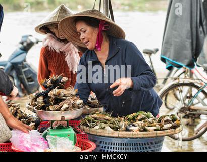 Crab vendor in the fish market, Hoi An, Vietnam - Stock Photo