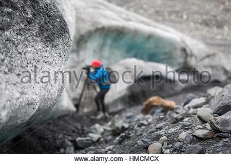 Photographer photographing Exit Glacier, Kenai Fjords, National Park, Alaska - Stock Photo