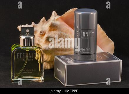 KIEV, UKRAINE - July 14, 2014: Calvin Klein Eternity for men fragrance and deodorant bottle and pack against black - Stock Photo