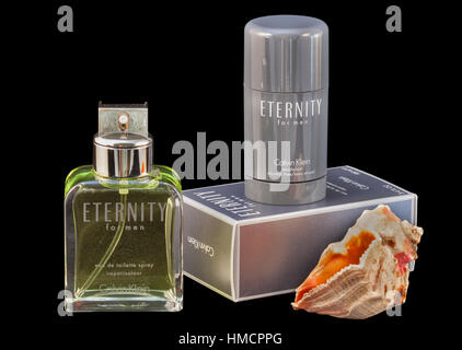 KIEV, UKRAINE - July 14, 2014: Calvin Klein Eternity for men fragrance and deodorant bottle and pack isolated against - Stock Photo