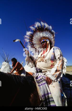 Native American on horseback wearing traditional clothes and feather headdress, annual commemoration of the Battle - Stock Photo