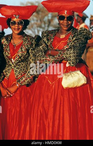 Herero women wearing traditional headgear, Okahandja, Namibia. - Stock Photo