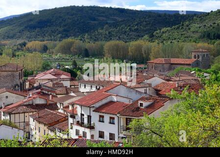 panoramic view of of Covarrubias, red roofs of houses in front, on right bell towers of Collegiate church of Saints - Stock Photo