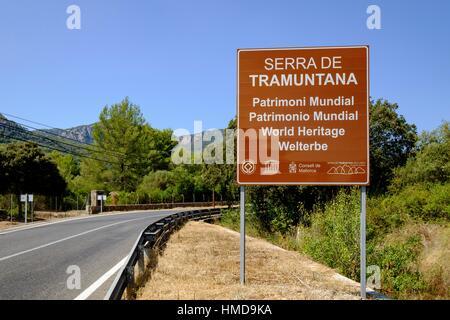 cartel anunciando la sierra de Tramuntana, patrimonio de la humanidad, Esporles, Majorca, Balearic Islands, Spain - Stock Photo