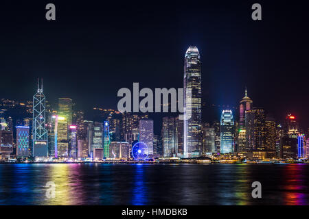Nightview of Victoria Harbour in Hong Kong. (Hong Kong Island side view from Tsim Sha Tsui) - Stock Photo