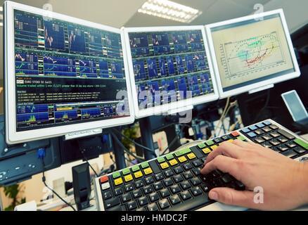 Stockbroker. Computer screens. stock market. charts - Stock Photo