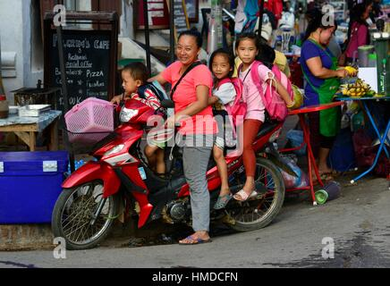 Family on motorbike in Luang Prabang, Laos, South East Asia. - Stock Photo