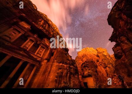 The Treasury, Petra Archaeological Park, with a starry sky overhead, Jordan. - Stock Photo