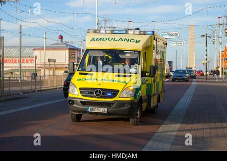 Emergency north west ambulance rushing through Blackpool, Lancashire, UK