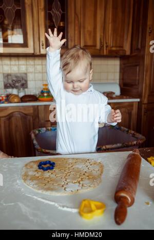 child baking cookies - Stock Photo