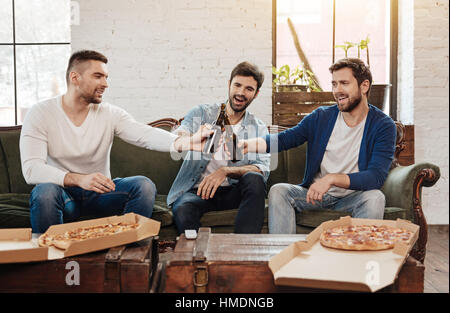 Nice happy friends cheering with beer - Stock Photo