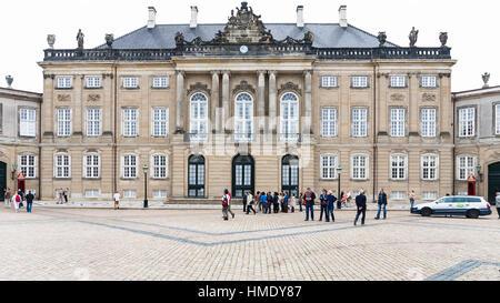 COPENHAGEN, DENMARK - SEPTEMBER 10, 2011: tourists near royal Christian VIII Palace in Amalienborg of Copenhagen - Stock Photo