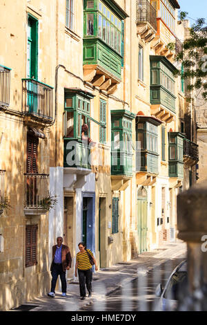 street in Valletta old town, Malta with colourful wooden balconies - Stock Photo