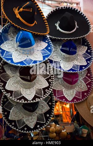 Colorful Mexican sombreros-hats for sale in a shop, San Miguel de Allende, Guanajuato state, Mexico, Central America. - Stock Photo