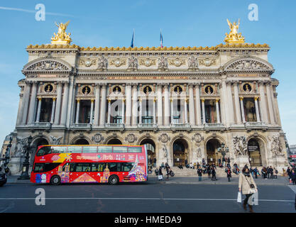 PARIS, FRANCE - CIRCA DECEMBER 2016: A CIty Sightseeing bus in front of the Palais Garnier. The Palais Garnier is - Stock Photo