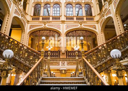 The ornate interior staircase of the landmark Postal Palace (Palacio de Correos de Mexico) located in downtown Mexico - Stock Photo