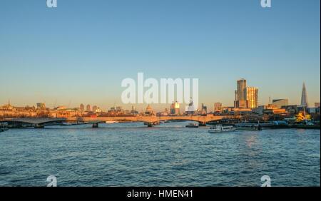 Skyline photo of London showing Waterloo bridge and the City beyond. - Stock Photo