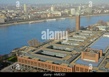 cCologne trade fair building and `Messeturm` tower along river Rhine - Stock Photo