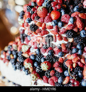 Fruits and flowers on banquet table - Stock Photo
