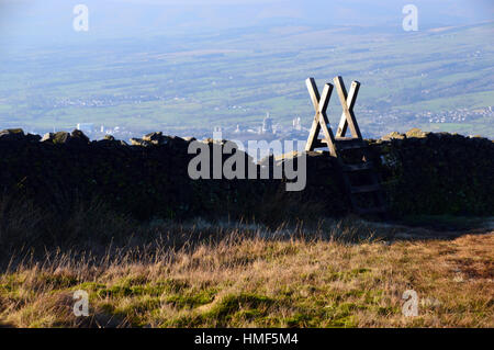 Wooden Ladder Stile over Dry Stone Wall on Pendle Hill above Clitheroe in the Ribble Valley, Lancashire England - Stock Photo