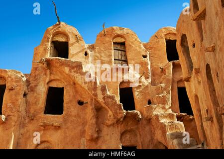 Ksar Ouled Soltane, a traditional Berber and Arab fortified adobe vaulted granary cellars, or ghorfas, situated - Stock Photo