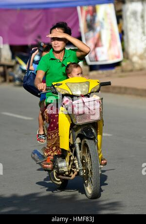 Family on motorbike in Luang Prabang,Laos, South East Asia. - Stock Photo