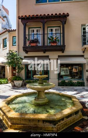 Spanish revival architecture and Palm trees along Worth Avenue in Palm Beach, Florida. - Stock Photo
